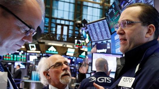 Stocks fall in choppy session, despite trade progress
