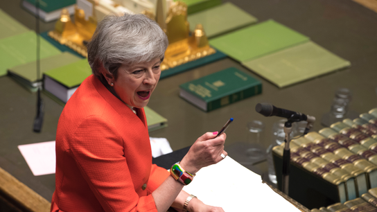The Latest: UK Parliament votes to hold May to Brexit vow