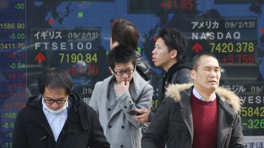 Asian stocks slip on Wall Street leads as trade talks simmer