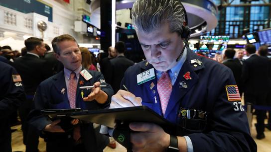Asian shares shrug off Wall St losses as China ends congress