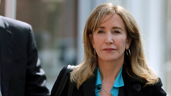 Felicity Huffman sentenced to 14 days in prison in college cheating scandal