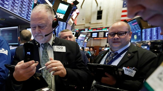 Stocks struggle on weak manufacturing data, interest rate worries
