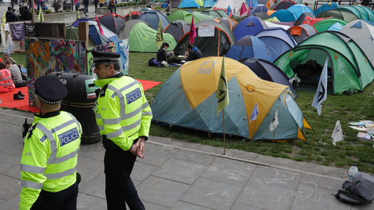 UK police arrest more than 200 in climate change protests