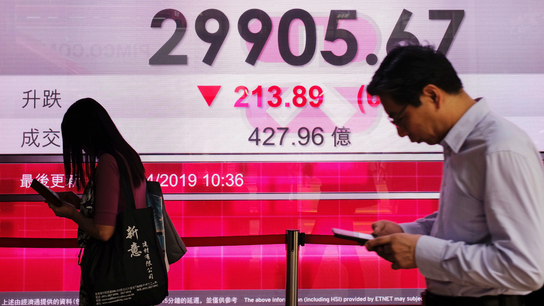 Asian shares fall as Fed minutes show data may tweak stance