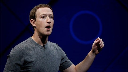 Facebook CEO Mark Zuckerberg survives leadership vote at annual meeting