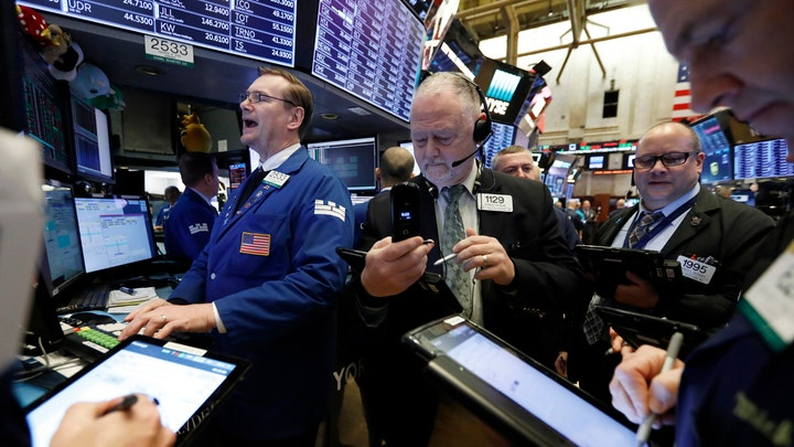 Stocks open session marginally lower, but heading for month of gains