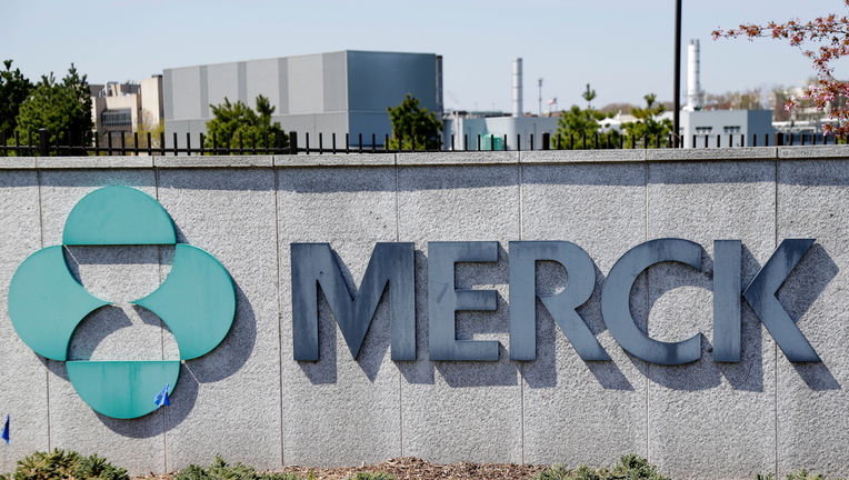 Merck reports surging sales of vaccines and key cancer drug