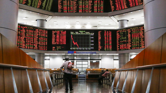World stocks waver as Fed steers clear of signaling rate cut