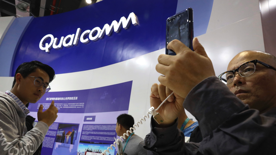 The Latest: Qualcomm defeat might not lower phone prices