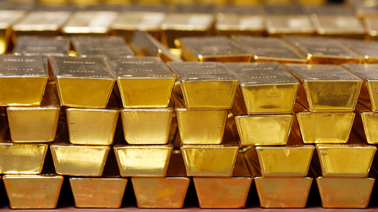 After a delay, gold shines as trade battles hit stocks