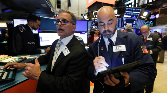 Stocks post small losses; investors look ahead to Fed