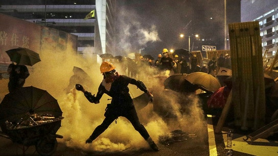 Protesters clash in Hong Kong as cycle of violence intensifies