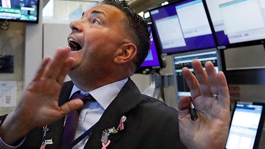 Nasdaq Composite hits new high on Powell comments