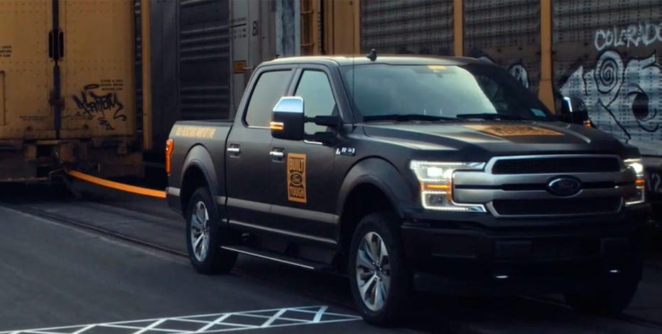 Electric Ford F-150 prototype shown towing a freight train
