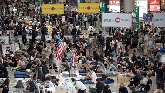 Protesters, police clash in Hong Kong airport chaos