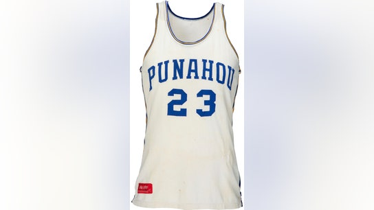 Obama's high school basketball jersey scores $120K at auction