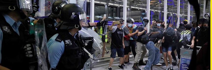 HONG KONG PROTESTERS MOB AIRPORT AS VIOLENCE ERUPTS, FLIGHTS CANCELED