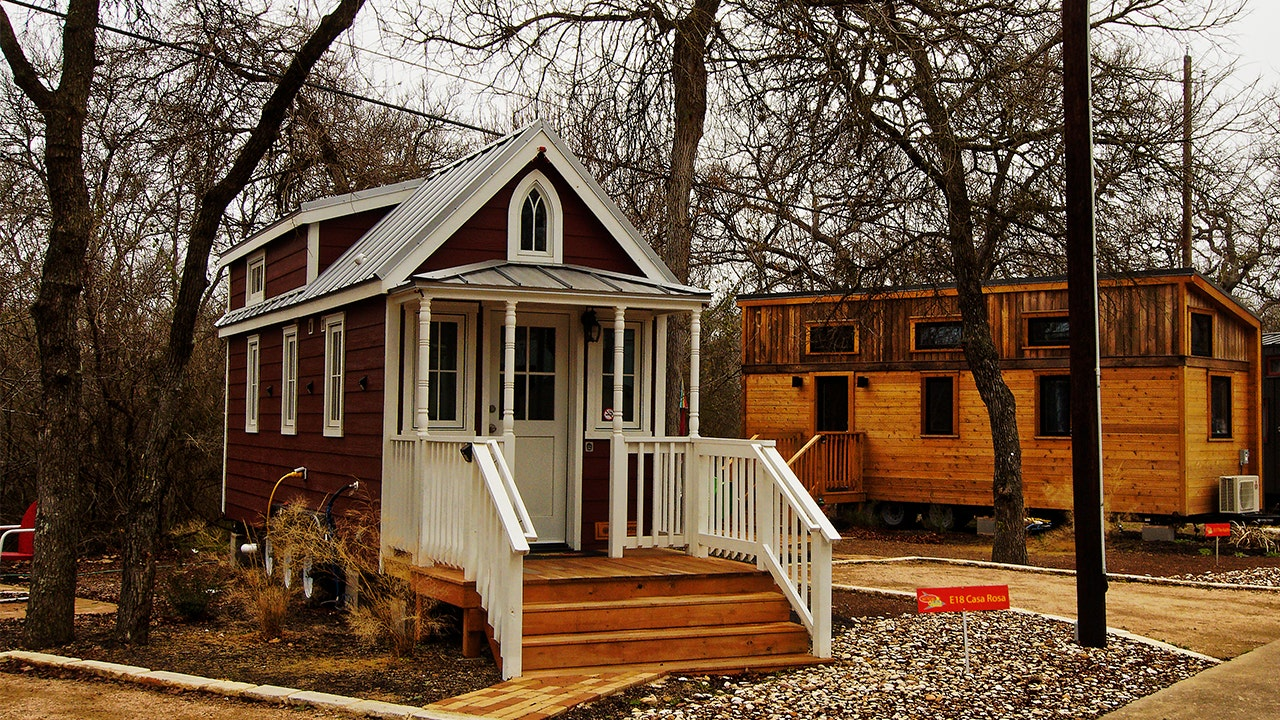Tiny house trend: Why so many people are looking to live ... on tiny house storage, tiny simple house plans, tiny houses on wheels, tiny modern house plans, tiny house carport, tiny house plans southern living, tiny house ideas, house designs with porches, old screened in porches, tiny house design, tiny house trailer plans, tiny house with bedroom downstairs, tiny house forum, tiny house bathrooms,