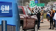 GM gets jab from UAW, members want cars built in USA as strike drags on