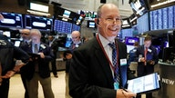 Stocks secure fresh records as US economy tops expectations