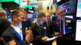 Stocks rally to fresh records as Nasdaq blows past 9,000 mark for first time