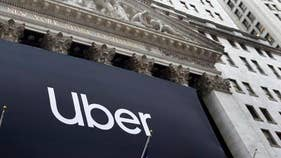 Uber's losses shrink as bookings spike