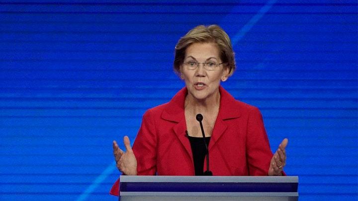 Warren runs 'fake' ad dissing Facebook