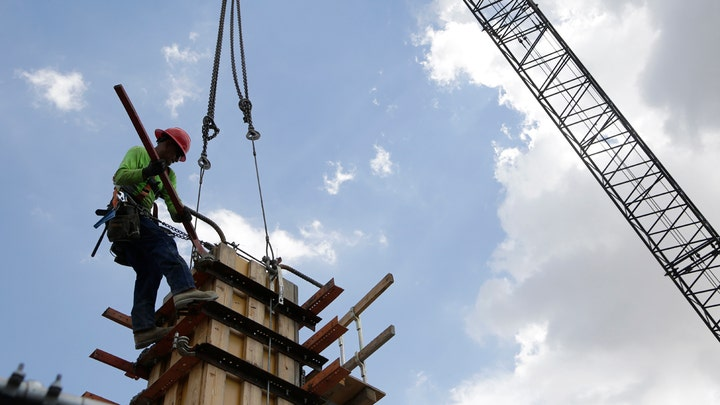 US economy grew faster than previously thought