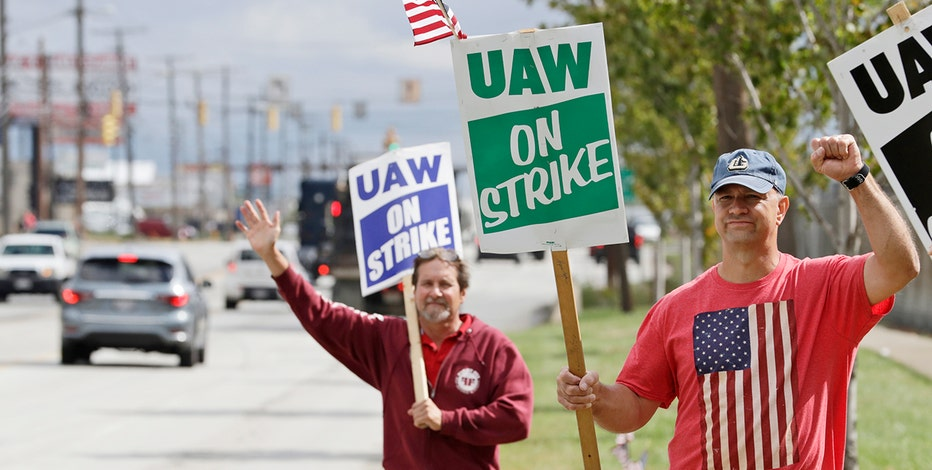 General Motors restores striking workers' health insurance