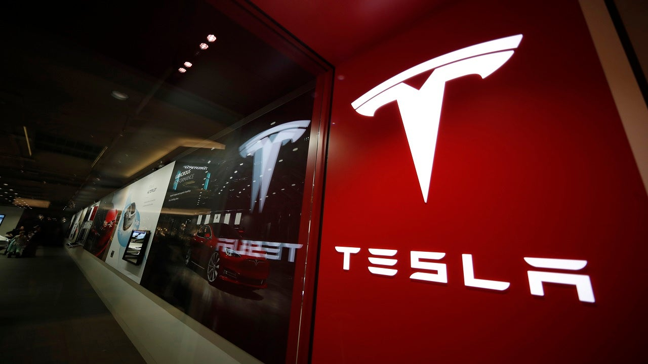 Tesla speeds past Wall Street expectations for milestone profit