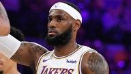 LeBron James defends himself after receiving criticism for shoeless celebration