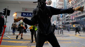 Hong Kong violence escalates with Molotov cocktails, tear gas
