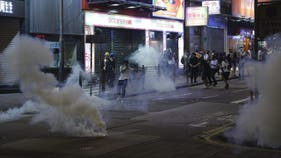Hong Kong enters recession as street protests erupt in flames