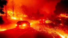 Fire rages despite mass PG&E power outage