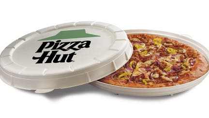 Pizza Hut to test plant-based 'meat' topping, compostable round box