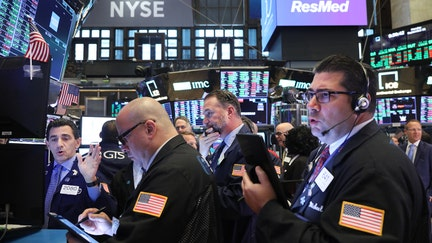Stocks close in on record highs as earnings, trade provide boost
