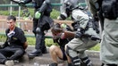 Police surround last holdouts at Hong Kong campus protest