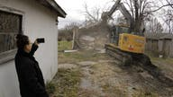 Home buyouts split apart a flood-prone Missouri town