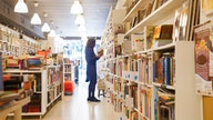 Overdue library books could cost this woman her job