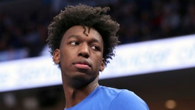 College basketball star banned, ordered to give to charity