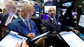 Trade optimism sends stocks to record highs