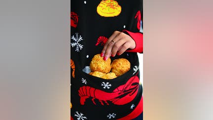 Red Lobster's new ugly sweater has a pocket for what?