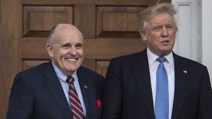 Then-President elect Donald Trump and Rudy Giuliani on Nov. 20, 2016. (Photo by Jabin Botsford/The Washington Post via Getty Images)