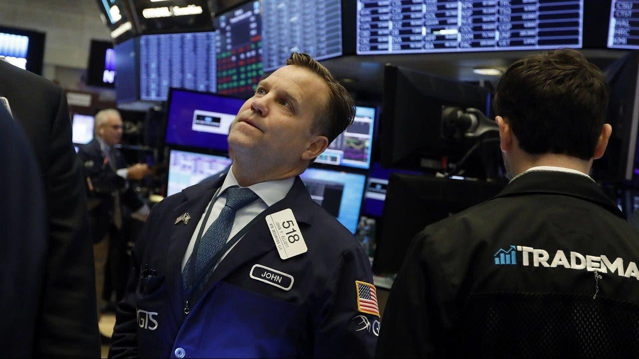 Stocks rally toward records as Tesla tops $900