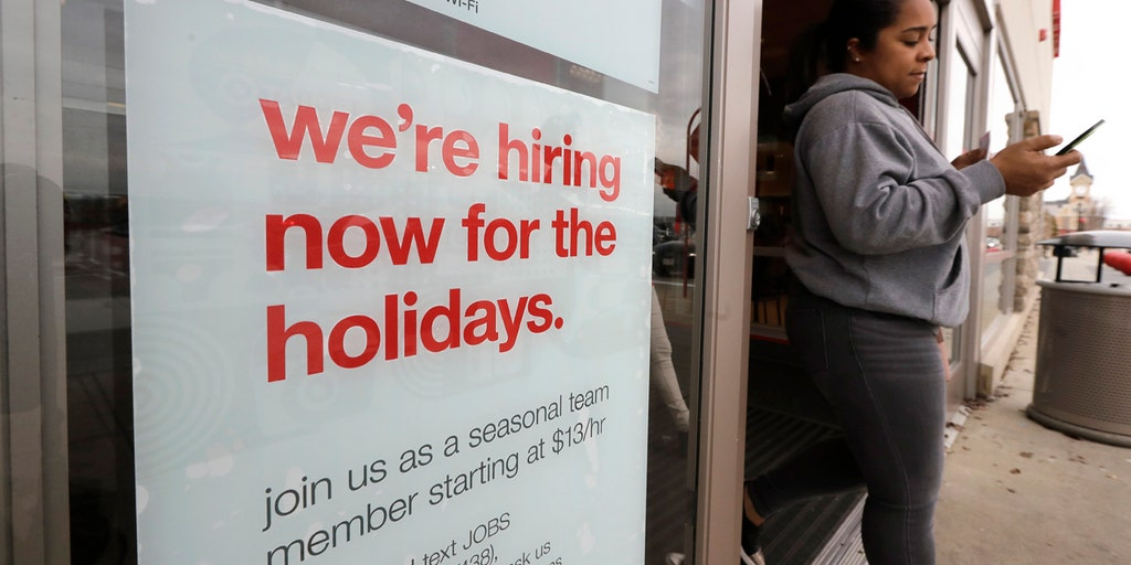 US job growth surges in November, with 266,000 added