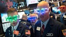 ROARING INTO '20s: Stocks rally on final day of the year, capping off banner decade