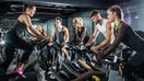 Cycling studios sweat competition from home fitness programs