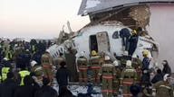 At least 12 killed, dozens hurt when plane slams into building after jarring takeoff