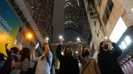 Hong Kong protesters stage New Year marches as authorities cancel midnight fireworks
