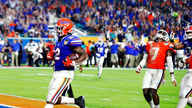 Perine leads No. 6 Gators past Virginia 36-28 in Orange Bowl